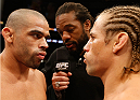 NEWARK, NJ - FEBRUARY 01:  (L-R) Opponents Renan Barao and Urijah Faber face off before their bantamweight championship fight at the UFC 169 event inside the Prudential Center on February 1, 2014 in Newark, New Jersey. (Photo by Josh Hedges/Zuffa LLC/Zuffa LLC via Getty Images)