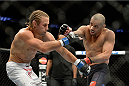 NEWARK, NJ - FEBRUARY 1:  (R-L) Renan Barao punches Uriah Faber in their bantamweight championship fight during the UFC 169 event at the Prudential Center on February 1, 2014 in Newark, New Jersey. (Photo by Jeff Bottari/Zuffa LLC/Zuffa LLC via Getty Images)