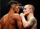 JARAGUA DO SUL, BRAZIL - FEBRUARY 14:  (L-R) Opponents Charles Oliveira and Andy Ogle face off during the UFC weigh-in at Arena Jaragua on February 14, 2014 in Jaragua do Sul, Santa Catarina, Brazil. (Photo by Josh Hedges/Zuffa LLC/Zuffa LLC via Getty Images)