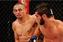 JARAGUA DO SUL, BRAZIL - FEBRUARY 15:  (L-R) Douglas Silva de Andrade punches Zubaira Tukhugov in their featherweight fight during the UFC Fight Night event at Arena Jaragua on February 15, 2014 in Jaragua do Sul, Santa Catarina, Brazil. (Photo by Josh Hedges/Zuffa LLC/Zuffa LLC via Getty Images)