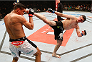 JARAGUA DO SUL, BRAZIL - FEBRUARY 15:  (R-L) Albert Tumenov kicks Ildemar Alcantara in their welterweight fight during the UFC Fight Night event at Arena Jaragua on February 15, 2014 in Jaragua do Sul, Santa Catarina, Brazil. (Photo by Josh Hedges/Zuffa LLC/Zuffa LLC via Getty Images)