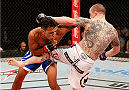 JARAGUA DO SUL, BRAZIL - FEBRUARY 15:  (R-L) Andy Ogle kicks Charles Oliveira in their featherweight fight during the UFC Fight Night event at Arena Jaragua on February 15, 2014 in Jaragua do Sul, Santa Catarina, Brazil. (Photo by Josh Hedges/Zuffa LLC/Zuffa LLC via Getty Images)