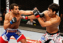 JARAGUA DO SUL, BRAZIL - FEBRUARY 15:  (L-R) Gegard Mousasi punches Lyoto Machida in their middleweight fight during the UFC Fight Night event at Arena Jaragua on February 15, 2014 in Jaragua do Sul, Santa Catarina, Brazil. (Photo by Josh Hedges/Zuffa LLC/Zuffa LLC via Getty Images)