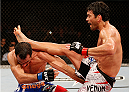 JARAGUA DO SUL, BRAZIL - FEBRUARY 15:  (R-L) Lyoto Machida kicks Gegard Mousasi in their middleweight fight during the UFC Fight Night event at Arena Jaragua on February 15, 2014 in Jaragua do Sul, Santa Catarina, Brazil. (Photo by Josh Hedges/Zuffa LLC/Zuffa LLC via Getty Images)