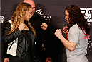 LAS VEGAS, NV - FEBRUARY 20:  (L-R) Opponents Ronda Rousey and Sara McMann face off during the final UFC 170 pre-fight press conference at the Mandalay Bay Resort and Casino on February 20, 2014 in Las Vegas, Nevada. (Photo by Josh Hedges/Zuffa LLC/Zuffa LLC via Getty Images)