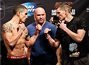 LAS VEGAS, NV - FEBRUARY 21:  (L-R) Opponents Robert Whittaker and Stephen Thompson face off during the UFC 170 weigh-in event at the Mandalay Bay Events Center on February 21, 2014 in Las Vegas, Nevada. (Photo by Josh Hedges/Zuffa LLC/Zuffa LLC via Getty Images)