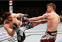 LAS VEGAS, NV - FEBRUARY 22:  (L-R) TJ Waldburger kicks Mike Pyle in their welterweight bout during UFC 170 inside the Mandalay Bay Events Center on February 22, 2014 in Las Vegas, Nevada. (Photo by Josh Hedges/Zuffa LLC/Zuffa LLC via Getty Images) *** Local Caption *** Mike Pyle; TJ Waldburger