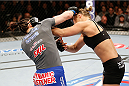 LAS VEGAS, NV - FEBRUARY 22:  (L-R) Sara McMann punches Ronda Rousey in their women's bantamweight championship bout during UFC 170 inside the Mandalay Bay Events Center on February 22, 2014 in Las Vegas, Nevada. (Photo by Josh Hedges/Zuffa LLC/Zuffa LLC via Getty Images) *** Local Caption *** Ronda Rousey; Sara McMann