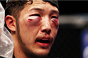 MACAU - MARCH 01:  Yui Chul Nam is bloodied and cut after battling Kazuki Tokudome in their lightweight fight during the UFC Fight Night event at the Venetian Macau on March 1, 2014 in Macau. (Photo by Mitch Viquez/Zuffa LLC/Zuffa LLC via Getty Images)