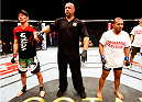 MACAU - MARCH 01:  (L to R) Hatsu Hioki and Ivan Menjivar react after the winner was called in their featherweight fight during the UFC Fight Night event at the Venetian Macau on March 1, 2014 in Macau. (Photo by Mitch Viquez/Zuffa LLC/Zuffa LLC via Getty Images)