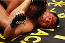 MACAU - MARCH 01:  Lipeng Zhang is bloodied by Wang Sai in their TUF China welterweight finals fight during the UFC Fight Night event at the Venetian Macau on March 1, 2014 in Macau. (Photo by Mitch Viquez/Zuffa LLC/Zuffa LLC via Getty Images)