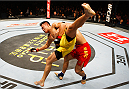 MACAU - MARCH 01:  Zhang Lipeng goes for a takedown on Wang Sai in their TUF China welterweight finals fight during the UFC Fight Night event at the Venetian Macau on March 1, 2014 in Macau. (Photo by Mitch Viquez/Zuffa LLC/Zuffa LLC via Getty Images)