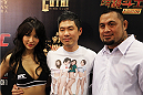 MACAU - MARCH 01: (L to R)  Azusa Nishigaki, a fan and Mark Hunt pose for a photo before the UFC Fight Night event at the Venetian Macau on March 1, 2014 in Macau. (Photo by Mitch Viquez/Zuffa LLC/Zuffa LLC via Getty Images)