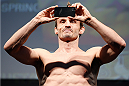 LONDON, ENGLAND - MARCH 07:  Brad Pickett snaps a cell phone picture as he weighs in during the UFC weigh-in event at the O2 Arena on March 7, 2014 in London, England. (Photo by Josh Hedges/Zuffa LLC/Zuffa LLC via Getty Images)