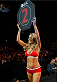 LONDON, ENGLAND - MARCH 08:  UFC Octagon Girl Carly Baker introduces a round during the UFC Fight Night London event at the O2 Arena on March 8, 2014 in London, England. (Photo by Josh Hedges/Zuffa LLC/Zuffa LLC via Getty Images)