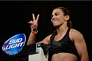 DALLAS, TX - MARCH 14:  Jessica Andrade steps on the scale during the UFC 171 weigh-in event at Gilley's Dallas on March 14, 2014 in Dallas, Texas. (Photo by Jeff Bottari/Zuffa LLC/Zuffa LLC via Getty Images)