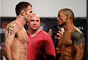 DALLAS, TX - MARCH 14:  (L-R) Opponents Jake Shields and Hector Lombard face off during the UFC 171 official weigh-in at Gilley's Dallas on March 14, 2014 in Dallas, Texas. (Photo by Josh Hedges/Zuffa LLC/Zuffa LLC via Getty Images)