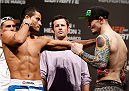 NATAL, BRAZIL - MARCH 22:  (L-R) Opponents Jussier Formiga and Scott Jorgensen face off during the UFC weigh-in at Ginasio Nelio Dias on March 22, 2014 in Natal, Brazil. (Photo by Josh Hedges/Zuffa LLC/Zuffa LLC via Getty Images)