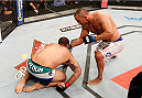 "NATAL, BRAZIL - MARCH 23:  Dan Henderson punches Mauricio ""Shogun"" Rua in their light heavyweight bout during the UFC Fight Night event at Ginasio Nelio Dias on March 23, 2014 in Natal, Brazil. (Photo by Josh Hedges/Zuffa LLC/Zuffa LLC via Getty Images)"