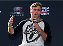 ABU DHABI, UNITED ARAB EMIRATES - APRIL 10:  UFC fighter Urijah Faber answers questions during a Q&A after the weighs-in for UFC Fight Night 39 on April 10, 2014 in Abu Dhabi, United Arab Emirates. UFC Fight Night 39 will take place on April 11 at du Arena featuring Antonio Rodrigo Nogueira and Roy Nelson.  (Photo by Warren Little/Zuffa LLC/Zuffa LLC via Getty Images)