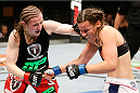 QUEBEC CITY, CANADA - APRIL 16:  (L-R) Sarah Kaufman punches Leslie Smith in their women's bantamweight fight during the TUF Nations Finale at Colisee Pepsi on April 16, 2014 in Quebec City, Quebec, Canada. (Photo by Josh Hedges/Zuffa LLC/Zuffa LLC via Getty Images)