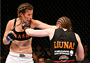 QUEBEC CITY, CANADA - APRIL 16:  (R-L) Sarah Kaufman punches Leslie Smith in their women's bantamweight fight during the TUF Nations Finale at Colisee Pepsi on April 16, 2014 in Quebec City, Quebec, Canada. (Photo by Josh Hedges/Zuffa LLC/Zuffa LLC via Getty Images)