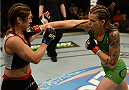 BALTIMORE, MD - APRIL 26:  (R-L) Jessamyn Duke punches Bethe Correia in their women's bantamweight bout during the UFC 172 event at the Baltimore Arena on April 26, 2014 in Baltimore, Maryland. (Photo by Patrick Smith/Zuffa LLC/Zuffa LLC via Getty Images)