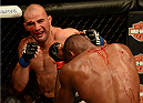 "BALTIMORE, MD - APRIL 26:  (L-R) Glover Teixeira punches Jon ""Bones"" Jones in their light heavyweight championship bout during the UFC 172 event at the Baltimore Arena on April 26, 2014 in Baltimore, Maryland. (Photo by Patrick Smith/Zuffa LLC/Zuffa LLC via Getty Images)"