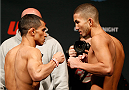 CINCINNATI, OH - MAY 09:  (L-R) Opponents Chris Cariaso and Louis Smolka face off during the UFC weigh-in at the U.S. Bank Arena on May 9, 2014 in Cincinnati, Ohio. (Photo by Josh Hedges/Zuffa LLC/Zuffa LLC via Getty Images)