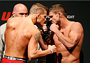 CINCINNATI, OH - MAY 09:  (L-R) Opponents Erik Koch and Daron Cruickshank face off during the UFC weigh-in at the U.S. Bank Arena on May 9, 2014 in Cincinnati, Ohio. (Photo by Josh Hedges/Zuffa LLC/Zuffa LLC via Getty Images)