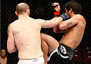 CINCINNATI, OH - MAY 10:  (L-R) Zak Cummings punches Yan Cabral in their welterweight fight during the UFC Fight Night event at the U.S. Bank Arena on May 10, 2014 in Cincinnati, Ohio. (Photo by Josh Hedges/Zuffa LLC/Zuffa LLC via Getty Images)