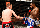 CINCINNATI, OH - MAY 10:  (R-L) Neil Magny kicks Tim Means in their welterweight fight during the UFC Fight Night event at the U.S. Bank Arena on May 10, 2014 in Cincinnati, Ohio. (Photo by Josh Hedges/Zuffa LLC/Zuffa LLC via Getty Images)