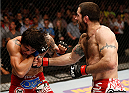 CINCINNATI, OH - MAY 10:  (R-L) Matt Brown punches Erick Silva in their welterweight fight during the UFC Fight Night event at the U.S. Bank Arena on May 10, 2014 in Cincinnati, Ohio. (Photo by Josh Hedges/Zuffa LLC/Zuffa LLC via Getty Images)