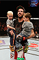 CINCINNATI, OH - MAY 10:  Matt Brown stands in the Octagon with his twin boys after his TKO victory over Erick Silva in their welterweight fight during the UFC Fight Night event at the U.S. Bank Arena on May 10, 2014 in Cincinnati, Ohio. (Photo by Josh Hedges/Zuffa LLC/Zuffa LLC via Getty Images)