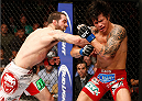 CINCINNATI, OH - MAY 10:  (L-R) Matt Brown punches Erick Silva in their welterweight fight during the UFC Fight Night event at the U.S. Bank Arena on May 10, 2014 in Cincinnati, Ohio. (Photo by Josh Hedges/Zuffa LLC/Zuffa LLC via Getty Images)