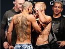 LAS VEGAS, NV - MAY 23:  (L-R) Opponents Renan Barao and T.J. Dillashaw face off during the UFC 173 weigh-in at the MGM Grand Garden Arenaon May 23, 2014 in Las Vegas, Nevada.  (Photo by Josh Hedges/Zuffa LLC/Zuffa LLC via Getty Images)