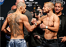 LAS VEGAS, NV - MAY 23:  (L-R) Opponents Renan Barao and T.J. Dillashaw shake hands during the UFC 173 weigh-in at the MGM Grand Garden Arenaon May 23, 2014 in Las Vegas, Nevada.  (Photo by Josh Hedges/Zuffa LLC/Zuffa LLC via Getty Images)