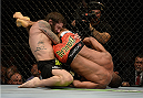 LAS VEGAS, NV - MAY 24:  (R-L) Francisco Trinaldo attempts an arm bar on Michael Chiesa in their lightweight bout during the UFC 173 event at the MGM Grand Garden Arena on May 24, 2014 in Las Vegas, Nevada. (Photo by Jeff Bottari/Zuffa LLC/Zuffa LLC via Getty Images)
