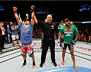 LAS VEGAS, NV - MAY 24:  Takeya Mizugaki (left) reacts to his victory over Francisco Rivera (right) in their bantamweight bout during the UFC 173 event at the MGM Grand Garden Arena on May 24, 2014 in Las Vegas, Nevada. (Photo by Josh Hedges/Zuffa LLC/Zuffa LLC via Getty Images)