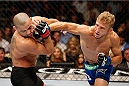 LAS VEGAS, NV - MAY 24:  (R-L) T.J. Dillashaw punches Renan Barao in their bantamweight championship bout during the UFC 173 event at the MGM Grand Garden Arena on May 24, 2014 in Las Vegas, Nevada. (Photo by Josh Hedges/Zuffa LLC/Zuffa LLC via Getty Images)