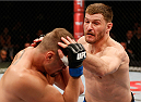 SAO PAULO, BRAZIL - MAY 31:  (R-L) Stipe Miocic punches Fabio Maldonado in their heavyweight fight during the UFC Fight Night event at the Ginasio do Ibirapuera on May 31, 2014 in Sao Paulo, Brazil. (Photo by Josh Hedges/Zuffa LLC/Zuffa LLC via Getty Images)