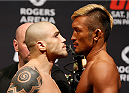 VANCOUVER, BC - JUNE 13:  (L-R) Opponents Daniel Sarafian and Kiichi Kunimoto face off during the UFC 174 weigh-in at Rogers Arena on June 13, 2014 in Vancouver, Canada.  (Photo by Josh Hedges/Zuffa LLC/Zuffa LLC via Getty Images)