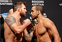 "VANCOUVER, BC - JUNE 13:  (L-R) Opponents Ryan Bader and Rafael ""Feijao"" Cavalcante face off during the UFC 174 weigh-in at Rogers Arena on June 13, 2014 in Vancouver, Canada.  (Photo by Josh Hedges/Zuffa LLC/Zuffa LLC via Getty Images)"