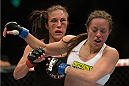 VANCOUVER, BC - JUNE 14:  (L-R) Valerie Latourneau punches Elizabeth Phillips during the UFC 174 event at Rogers Arena on June 14, 2014 in Vancouver, British Columbia, Canada. (Photo by Jeff Bottari/Zuffa LLC/Zuffa LLC via Getty Images)