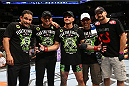 SAN ANTONIO, TX - JUNE 28:  Cub Swanson (center) poses with his teammates after his featherweight bout at the AT&T Center on June 28, 2014 in San Antonio, Texas. (Photo by Ed Mulholland/Zuffa LLC/Zuffa LLC via Getty Images)