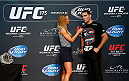 LAS VEGAS, NV - JULY 02:  (R-L) UFC middleweight champion Chris Weidman is interviewed by Carolyn Pearce before an open training session ahead of UFC 175 at the Fashion Show Mall on July 2, 2014 in Las Vegas, Nevada.  (Photo by Josh Hedges/Zuffa LLC/Zuffa LLC via Getty Images)