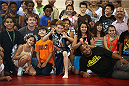 LAS VEGAS, NV - JULY 1:  Children from the Boys & Girls Club of Las Vegas interact with UFC fighters Daniel Cormier (R) and Matt Hughes (L) as the UFC, Ultimate Alliance and Boys & Girls Club of Las Vegas announce a partnership to host after school wrestling programs to kick off the UFC International Fight Week at the Boys & Girls Club of Southern Nevada on July 1, 2014 in Las Vegas, Nevada. (Photo by Brandon Magnus/Zuffa LLC/Zuffa LLC via Getty Images)