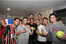 LAS VEGAS, NV - JULY 1:  (L-R) Forrest Griffin, Daniel Cormier, Luke Rockhold, and Joseph Benavidez pose with fans as they watch the 2014 FIFA World Cup Brazil Round of 16 match between USA and Belgium with fans to kick off the UFC International Fight Week at Legasse's Stadium at The Palazzo Las Vegas on July 1, 2014 in Las Vegas, Nevada. (Photo by Brandon Magnus/Zuffa LLC/Zuffa LLC via Getty Images)