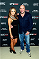LAS VEGAS, NV - JULY 1:  (L-R) UFC Octagon Girl and artist Brittney Palmer and UFC President Dana White arrive at the Art of Fighting Exhibition to kick off the UFC International Fight Week at The Gallery on 1217 on July 1, 2014 in Las Vegas, Nevada. (Photo by Jeff Bottari/Zuffa LLC/Zuffa LLC via Getty Images)