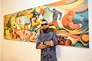 LAS VEGAS, NV - JULY 1:  Artist Brian Kirhagis poses in front of his main art piece at the Art of Fighting Exhibition to kick off the UFC International Fight Week at The Gallery on 1217 on July 1, 2014 in Las Vegas, Nevada. (Photo by Jeff Bottari/Zuffa LLC/Zuffa LLC via Getty Images)